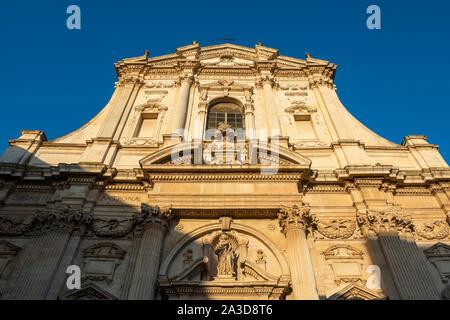 Early morning sun illuminates the façade of the baroque church Chiesa di Santa Irene (Church of Saint Irene) in Lecce, Apulia (Puglia) in Southern Ita - Stock Photo