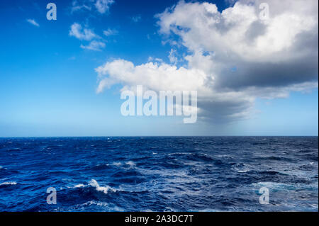 Background image of Atlantic ocean with cloud formations in the sky - Stock Photo