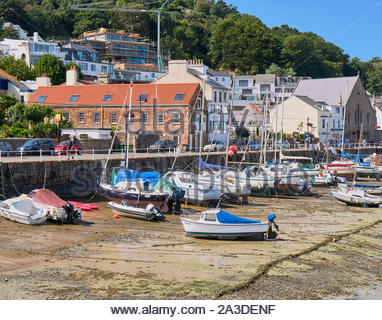 Many boats in the harbour in the seaside town of St Aubin in Jersey in the channel Islands uk - Stock Photo