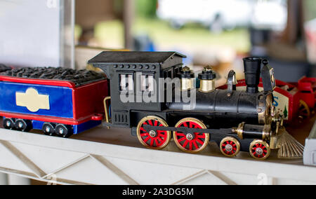 A toy steam engine with a coal car, would make any little boy light up in delight - Stock Photo
