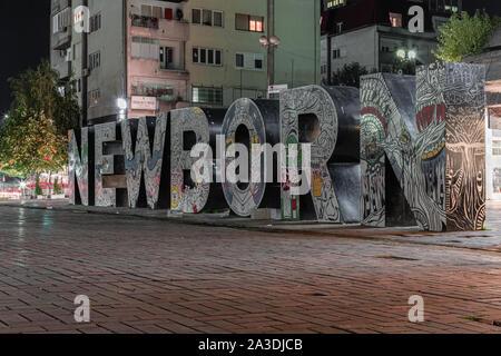 Newborn monument in Pristina Kosovo. - Stock Photo