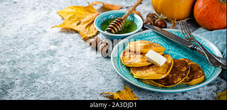 Pumpkin pancakes on rustic wood background - Stock Photo