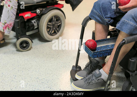 Disabled Boccia player training on a wheelchair - Stock Photo