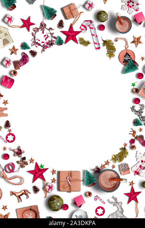 Creative Christmas frame composition, made of Christmas decorative elements, baubles, pine cones, stars, spruce branches on red background. New Year g - Stock Photo