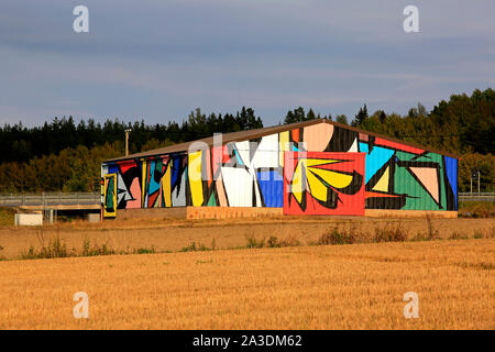Abstract mural by Sobekcis on a barn in field near the national road 1, E18, in Salo, Finland. The public art project is part of Upeart Festival 2019. - Stock Photo