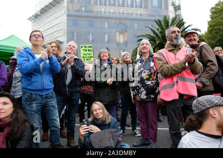 Westminster, London, UK - Monday 7th October 2019 - Extinction Rebellion XR climate protesters applaud a speech as they block the northern side of Lambeth Bridge. Photo Steven May / Alamy Live News - Stock Photo