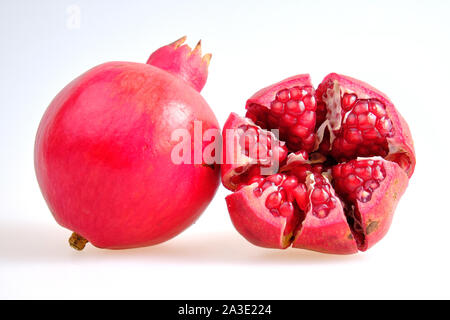 Cut fruit pomegranates isolated on white background ready to use in designs Stock Photo