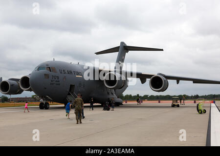 A massive Boeing C-17 Globemaster III cargo plane sits on static display at the Fort Wayne Airshow in Fort Wayne, Indiana, USA. - Stock Photo