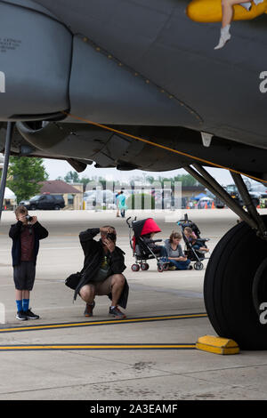 A boy and his father photograph an iconic B-17 bomber at the Fort Wayne Airshow in Fort Wayne, Indiana, USA. - Stock Photo
