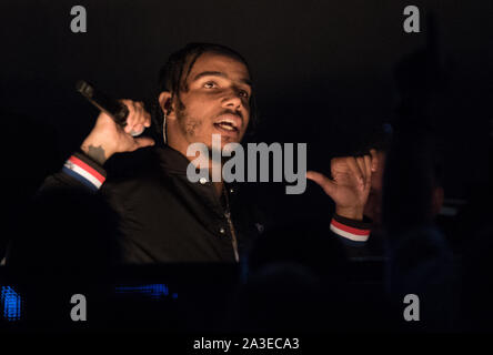 06/10/2019  London UK - AJ TRACEY  takes to the stage for the first-ever NFL London Games Halftime Show, presented by GoUSA TV. The British rap artist  performance at the  NFL game  Chicago Bear's vs Oakland Raiders at Tottenham Hotspur Stadium on Sunday, October 6 - Stock Photo