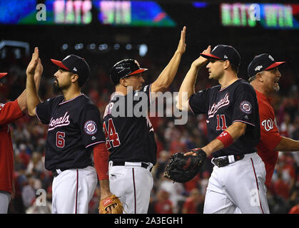 Washington, United States. 07th Oct, 2019. Washington Nationals first baseman Ryan Zimmerman (11) celebrates with first base coach Tim Bogar (24) and Anthony Rendon (6) after a 6-1 NLDS game 4 win over the Los Angeles Dodgers at Nationals Park on Monday, October 7, 2019, in Washington, DC. The Washington victory evens the series at two games each. Photo by Kevin Dietsch/UPI Credit: UPI/Alamy Live News - Stock Photo