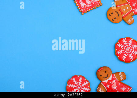 Christmas homemade gingerbread cookies on a bright colored background. New Year discount sale - Stock Photo