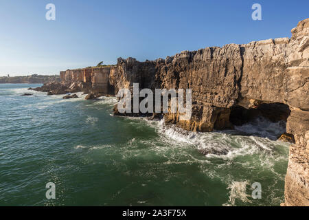 Scenic view of the Boca do Inferno (Hell's Mouth) in Cascais, Portugal, on a sunny day. It's a chasm in seaside cliff and popular tourist attraction. - Stock Photo