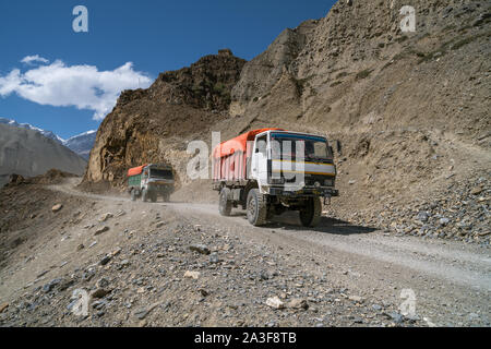 Trucks on the road from Upper Mustang to Kagbeni, Nepal - Stock Photo
