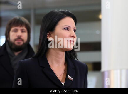Khimki, Russia. 08th Oct, 2019. MOSCOW REGION, RUSSIA - OCTOBER 8, 2019: Russian State Duma member Inga Yumasheva (front) arrives at Sheremetyevo International Airport after a visit to the United States; Yumasheva was questioned for about an hour by the FBI at a New York City airport on 5 October 2019 after she arrived in the US to attend Fort Ross Dialogue 2019 in California; the Russian Embassy in the United States sent a note of protest to the US State Department over the incident. Vladimir Gerdo/TASS Credit: ITAR-TASS News Agency/Alamy Live News - Stock Photo
