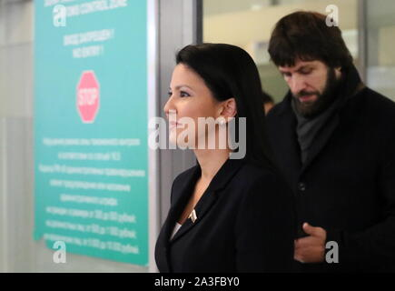 Khimki, Russia. 08th Oct, 2019. MOSCOW REGION, RUSSIA - OCTOBER 8, 2019: Russian State Duma member Inga Yumasheva (L) arrives at Sheremetyevo International Airport after a visit to the United States; Yumasheva was questioned for about an hour by the FBI at a New York City airport on 5 October 2019 after she arrived in the US to attend Fort Ross Dialogue 2019 in California; the Russian Embassy in the United States sent a note of protest to the US State Department over the incident. Vladimir Gerdo/TASS Credit: ITAR-TASS News Agency/Alamy Live News - Stock Photo