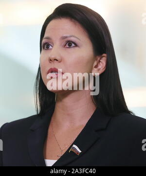 Khimki, Russia. 08th Oct, 2019. MOSCOW REGION, RUSSIA - OCTOBER 8, 2019: Russian State Duma member Inga Yumasheva talks to reporters at Sheremetyevo International Airport on return from a visit to the United States; Yumasheva was questioned for about an hour by the FBI at a New York City airport on 5 October 2019 after she arrived in the US to attend Fort Ross Dialogue 2019 in California; the Russian Embassy in the United States sent a note of protest to the US State Department over the incident. Vladimir Gerdo/TASS Credit: ITAR-TASS News Agency/Alamy Live News - Stock Photo