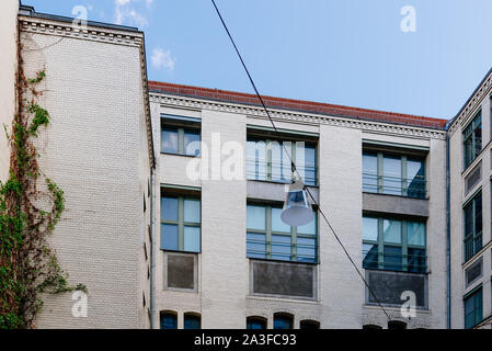 Berlin, Germany - July 27, 2019: Hackeschen Hofe complex. Traditional Berlin courtyards designed in the Jugendstil or Art Nouveau style by August Ende - Stock Photo