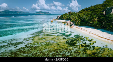 Aerial panoramic view of Anse Source d'Argent beach at La Digue island, Seychelles in the morning light. - Stock Photo