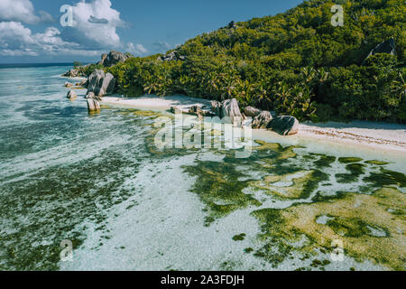 Aerial view of exotic Anse Source d'Argent beach at La Digue island, Seychelles. - Stock Photo