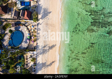 Top down view of Nusa Lembongan beach lined with resort and hotel in Bali, Indonesia - Stock Photo