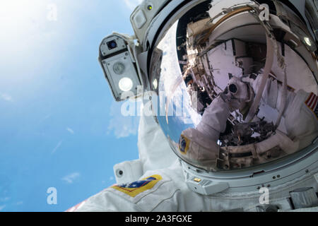 NASA astronaut Andrew Morgan takes a selfie during a spacewalk to upgrade International Space Station power systems October 6, 2019 in Earth Orbit. Morgan and fellow NASA astronaut Christina Koch, spent seven hours upgrading the orbiting laboratory large nickel-hydrogen batteries with newer, more powerful lithium-ion batteries. - Stock Photo
