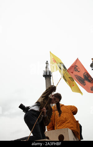 London, UK. 7th October 2019. Extinction Rebellion protesters seen on Trafalgar Square at a two week long protest in London. Credit: Joe Kuis / Alamy News - Stock Photo