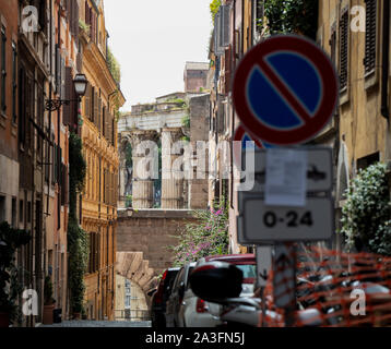 View of a typical Roman street, with tall & colourful buildings and at the end a view of the 1st century temple of Mars Ultor in the forum of Augustus - Stock Photo