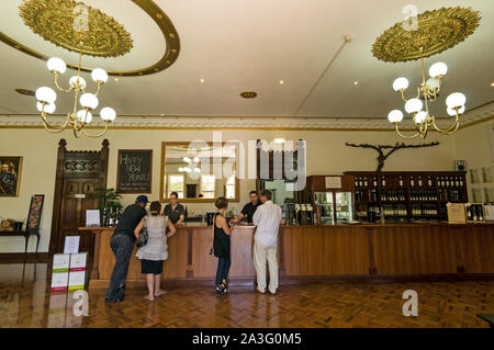 Visitors on a wine tour, wine tasting inside Chateau Yaldara on the McGulgan winery estate in the Barossa Valley wine region in South Australia.   The - Stock Photo