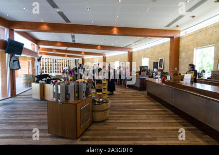 Bottles of wines on sale and wine tasting at the Wolf Blass winery visitors centre in the Barossa Valley wine region in South Australia.   There are a - Stock Photo