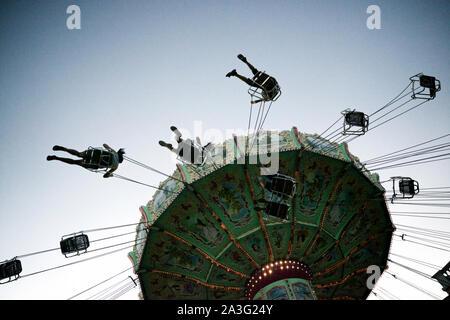 Vienna, Austria - June 21, 2019: tourists in Carousel at the Prater amusement park. - Stock Photo