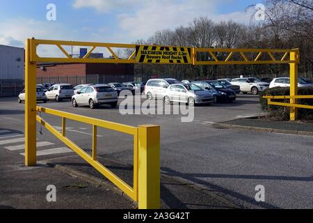 Camberley, Surrey, UK - February 6 2018: Entrance to a car park or parking lot, with a height restriction barrier to stop high vehicles entering - Stock Photo