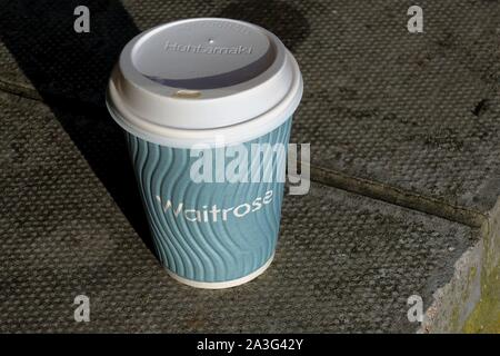 Camberley, Surrey, UK - February 6 2018: Waitrose paper coffee or tea cup, which have now been discontinued in favour of reusable cups - Stock Photo