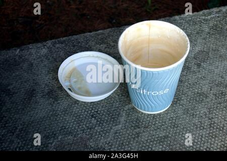 Camberley, Surrey, UK - February 6 2018: Discarded Waitrose paper coffee or tea cup, which have now been discontinued in favour of reusable cups - Stock Photo