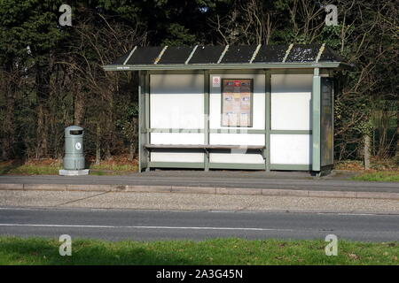 Camberley, Surrey, UK - February 6 2018: British bus stop shelter with nobody waiting for the bus - Stock Photo