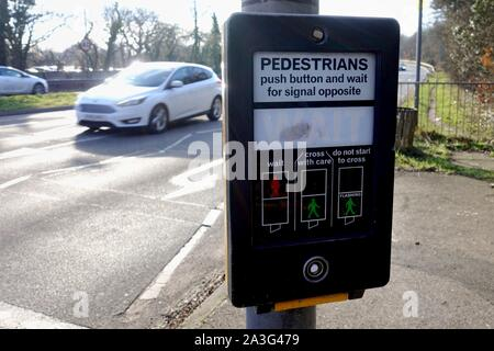 Camberley, Surrey, UK - February 6 2018: Pedestrian crossing button and control display, where people can push a button to change the traffic lights, - Stock Photo