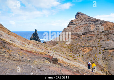 People walking on a hiking trail in Ponta de Sao Lourenco, Madeira, Portugal. Peninsula, easternmost point of the Portuguese island. Volcanic landscape. Hilly terrain. Hikers on a path. - Stock Photo