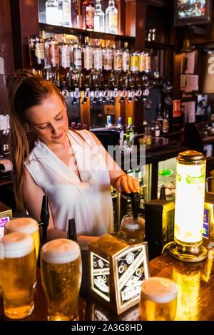 England, London, Southwark, Bermondsey, Barmaid In the Anchor Tap Sam Smiths Pub - Stock Photo