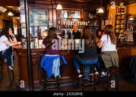 England, London, Southwark, Bermondsey, Women Sitting at The Bar Of The Anchor Tap Sam Smiths Pub - Stock Photo