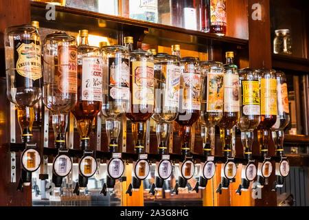 England, London, Southwark, Bermondsey, Display of Spirit Bottles at The Anchor Tap Sam Smiths Pub - Stock Photo