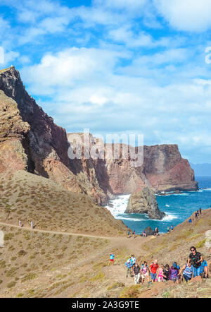 Ponta de Sao Lourenco, Madeira, Portugal - Sep 12 2019: Tourists on hiking trail in easternmost point of Madeira Island. Volcanic landscape and cliffs by Atlantic ocean. Overcrowded, mass tourism. - Stock Photo