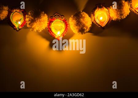 Indian festival Diwali, Diya oil lamps lit on colorful rangoli. Hindu traditional. Happy Deepavali. - Stock Photo