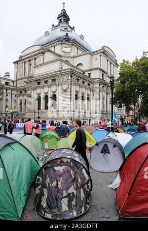 Westminster, London, UK. 8th October 2019. Extinction Rebellion activists block roads around Westminster in a second day of climate-change demonstrations with a road block at Broad Sanctuary. Credit: Malcolm Park/Alamy Live News. - Stock Photo