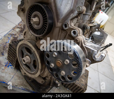 Attachment drive rollers on a car engine - Stock Photo