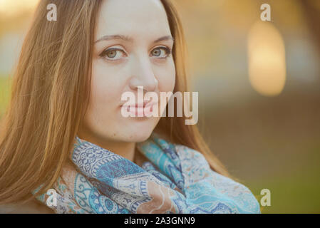 Pregnant woman sticks behind belly. Happy pregnancy time - Stock Photo