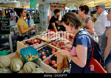 France, Var, Provence Verte, Cotignac, the market on the main square, melon stall - Stock Photo