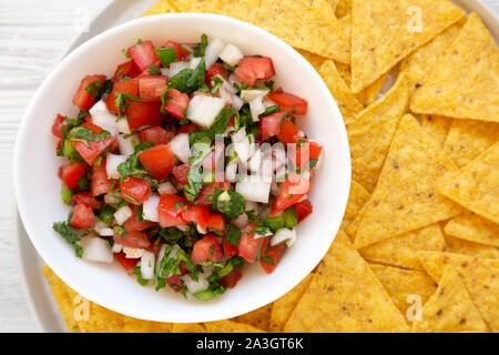 Pico de Gallo with gluten free chips, top view. Flat lay, overhead, from above. Close-up. - Stock Photo