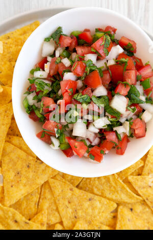 Pico de Gallo with gluten free tortilla chips, top view. Flat lay, overhead, from above. Closeup. - Stock Photo