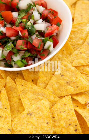 Pico de Gallo with gluten free tortilla chips, side view. Close-up. - Stock Photo
