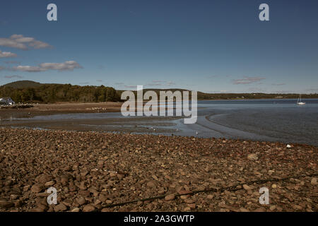A cool Fall day in Lincolnville Beach off the coast of Penobscot Bay in Lincolnville, Maine. - Stock Photo